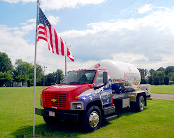 Auxier truck next to American flag