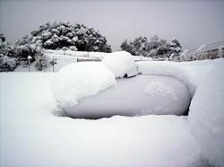 Image of propane tank under snow
