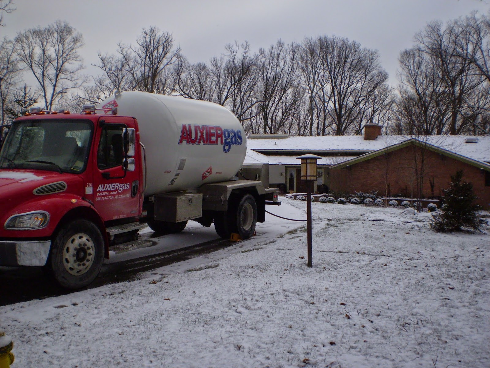 Image of Auxier Gas tank delivering propane