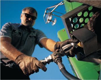 Image of man filling propane tank