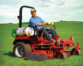Image of man on riding propane lawn mower